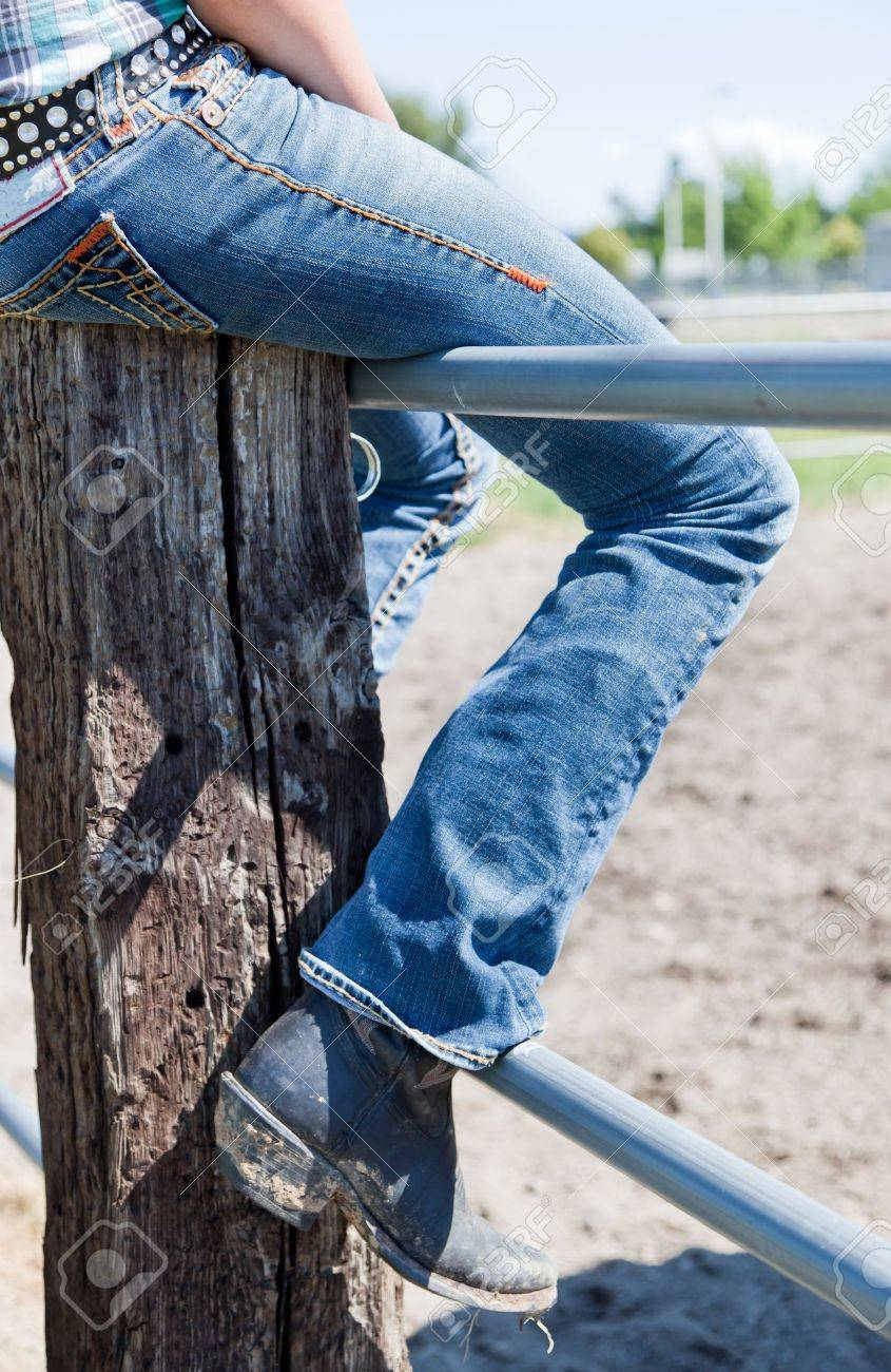 The Leg Of A Young Woman In Blue Jeans And Dirty Cowboy Boots ...