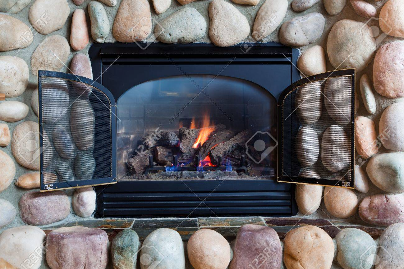 A Black Metal Framed Gas Fireplace Set In Colorful River Rocks Stock Photo Picture And Royalty Free Image Image 18434211