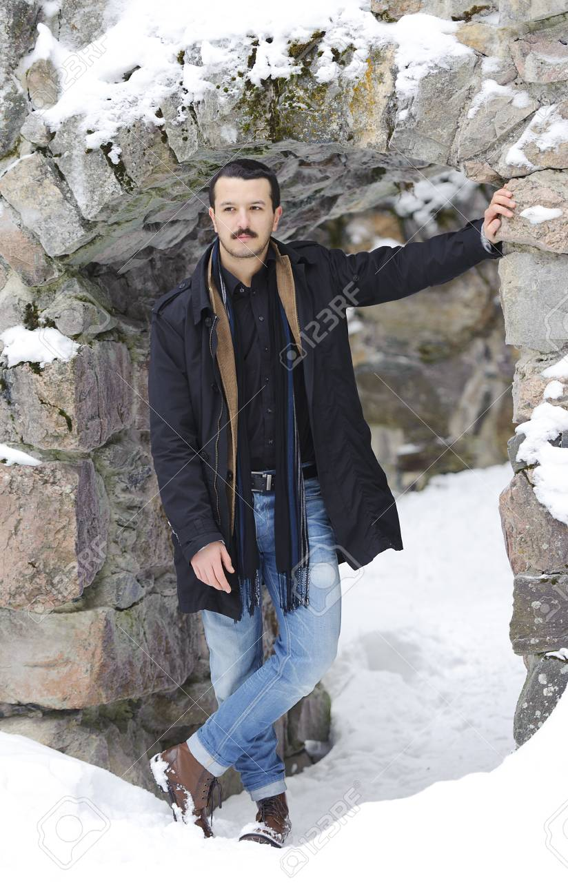 Portrait of a handsome young man in a full-length on the street in winter Stock Photo - 18212083