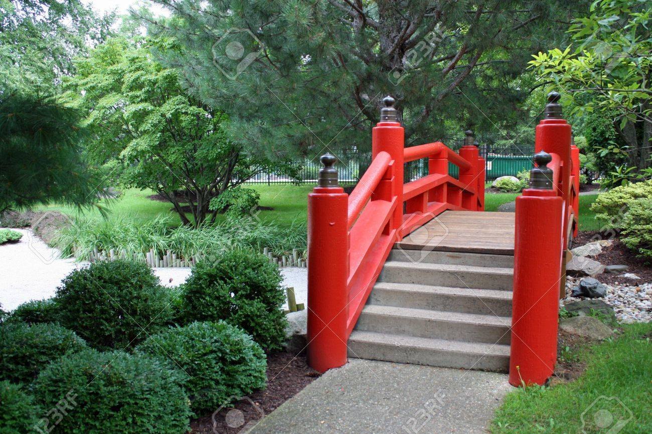 Red Japanese Garden Bridge red bridge in a japanese garden stock photo, picture and royalty