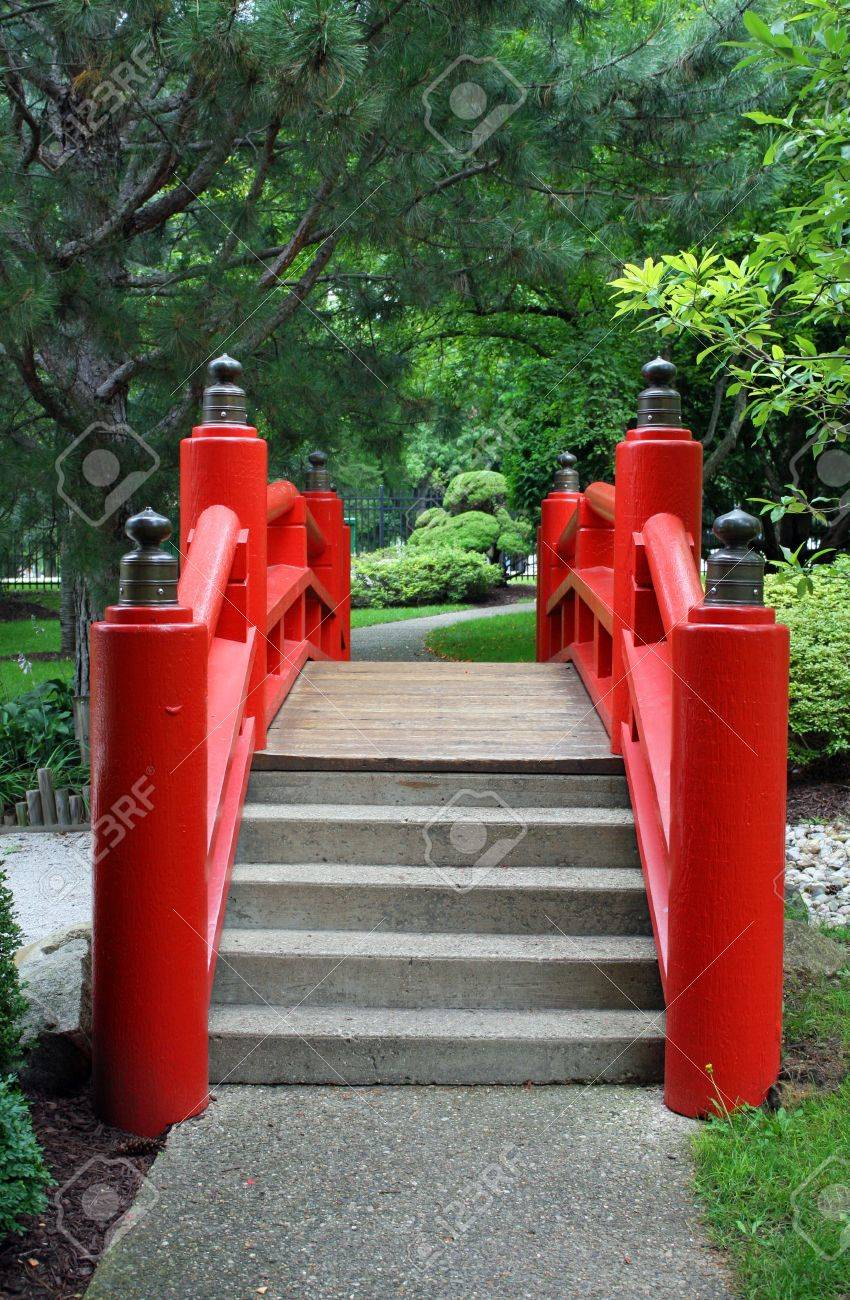 a red japanese garden bridge and path stock photo 12422239