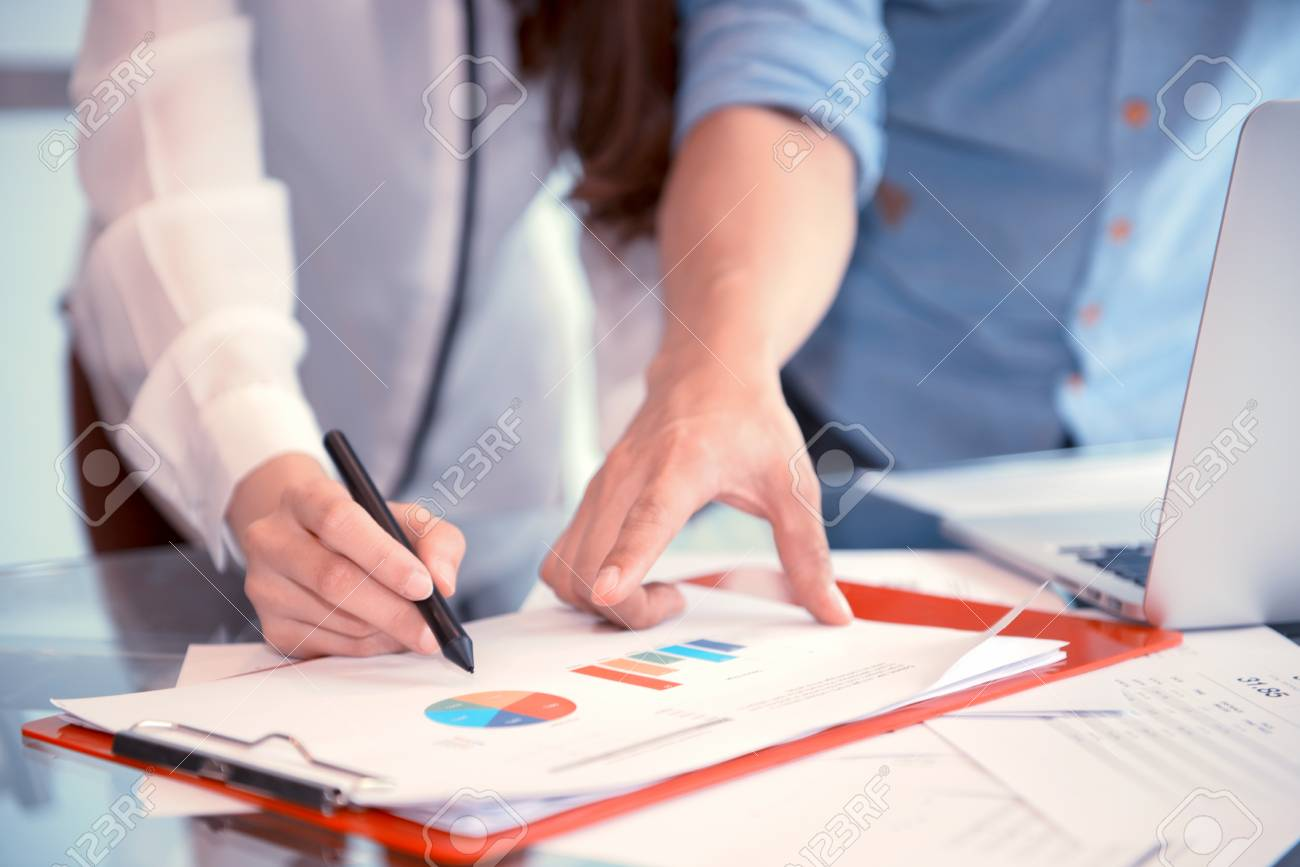 Discussing, writing, estimating business profit plan of company - 93878239