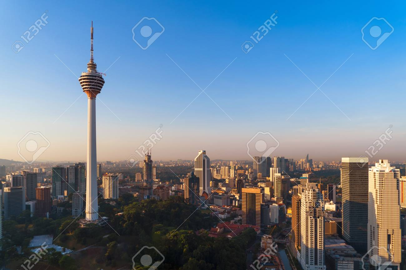 Menara Kuala Lumpur Tower with sunset sky. Aerial view of Kuala Lumpur Downtown, Malaysia. Financial district and business centers in urban city in Asia. Skyscraper and high-rise buildings at noon. - 118489863