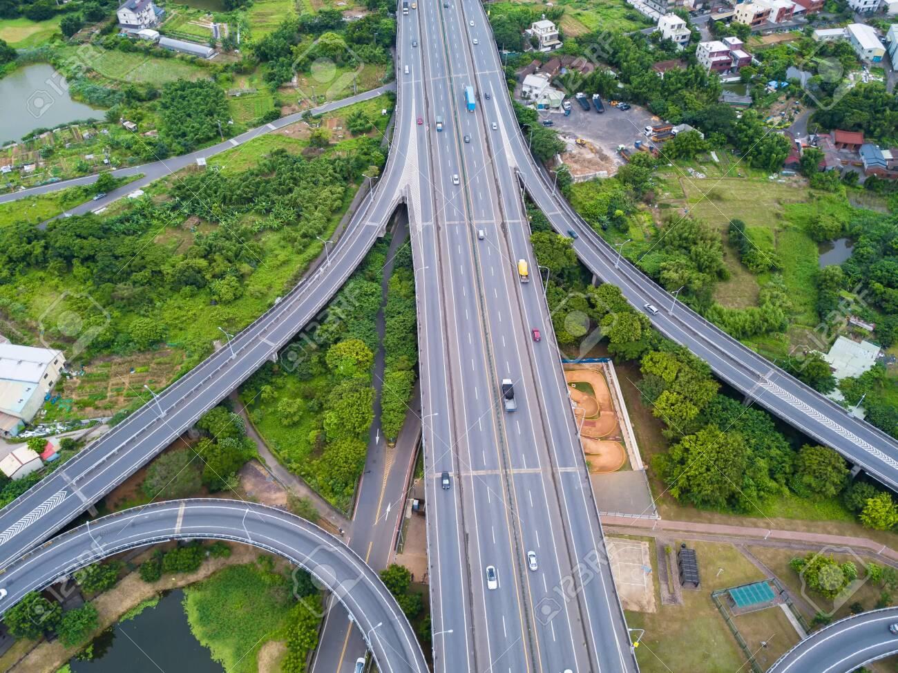 Aerial view of cars driving on highway junctions  Bridge roads