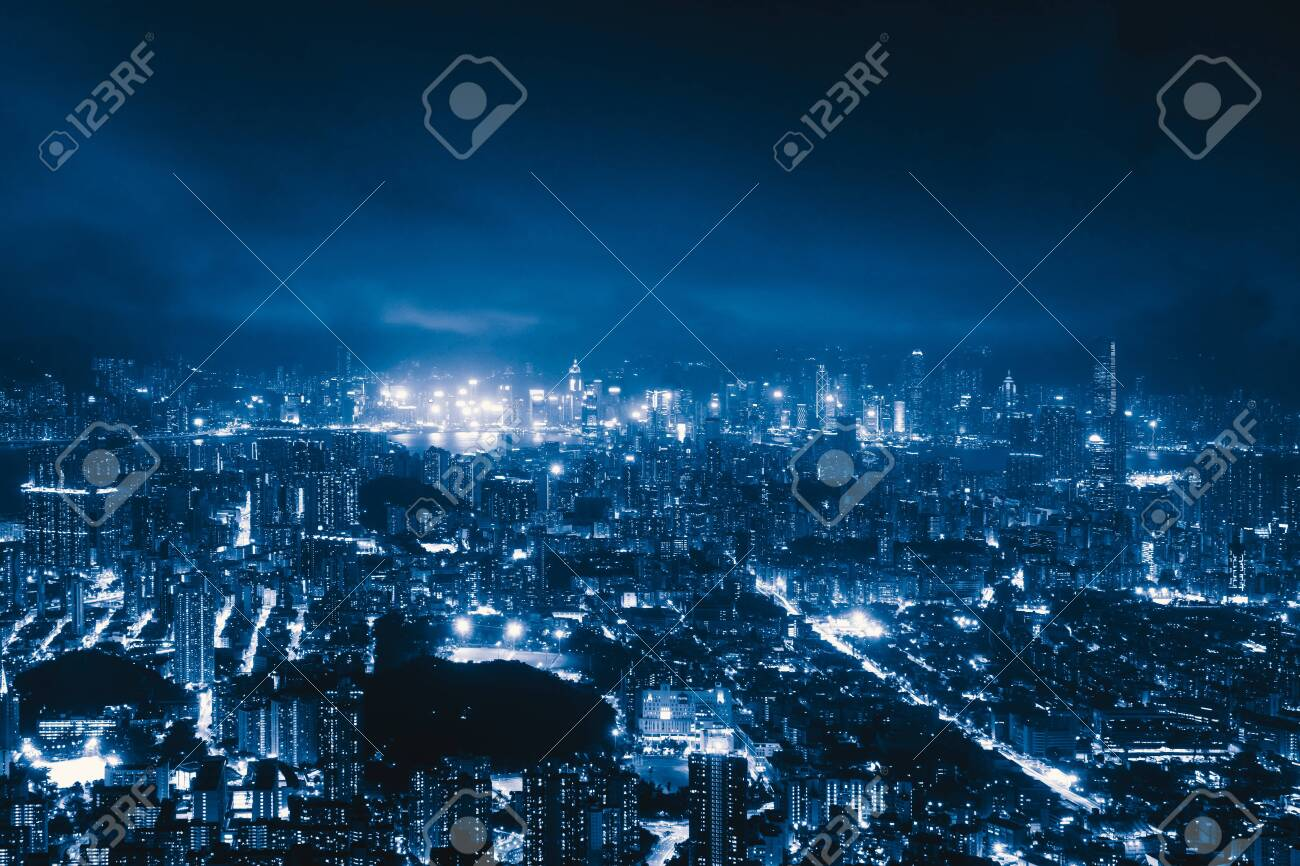 Aerial view of Hong Kong Downtown, Republic of China. Financial district and business centers in technology smart city in Asia. Top view of skyscraper and high-rise buildings at night. - 129953213