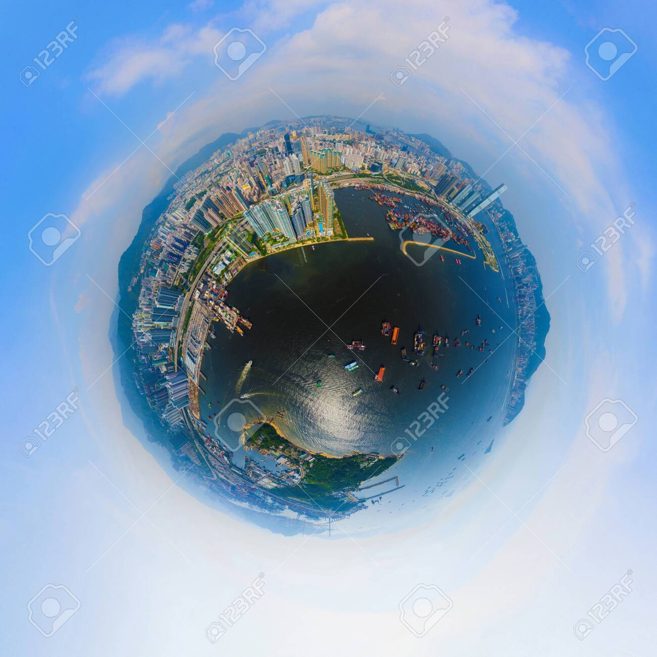 Little planet 360 degree sphere birds eye view. Panoramic view of aerial view of Hong Kong Downtown. Financial district and business centers in technology smart city. Skyscraper buildings at noon. - 130497411