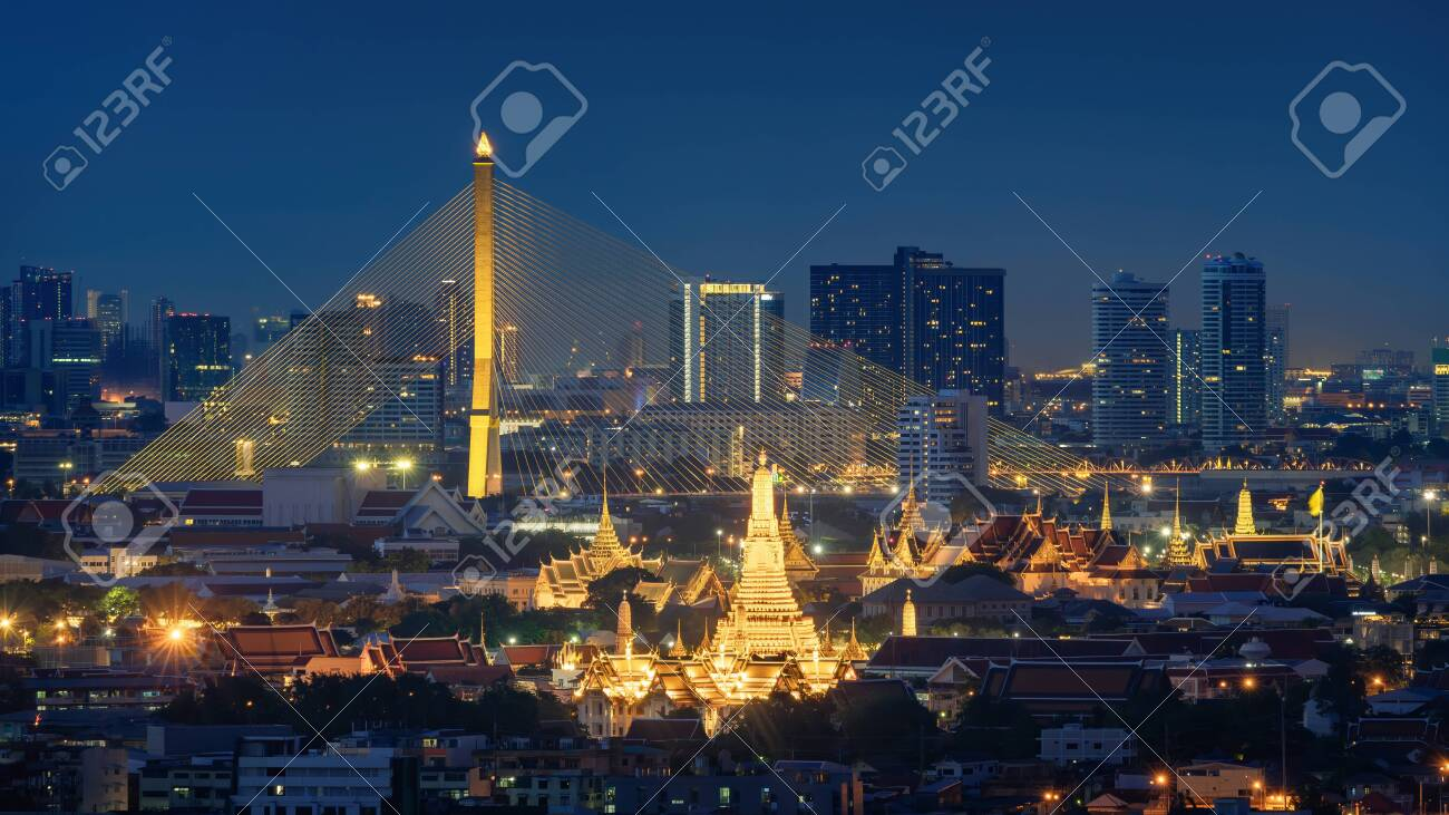 Aerial view of Rama 8 Bridge and Temple of Dawn or Wat Arun in Rattanakosin Island in architecture, Urban old town city, Bangkok skyline. downtown area, Thailand at night. - 153325073
