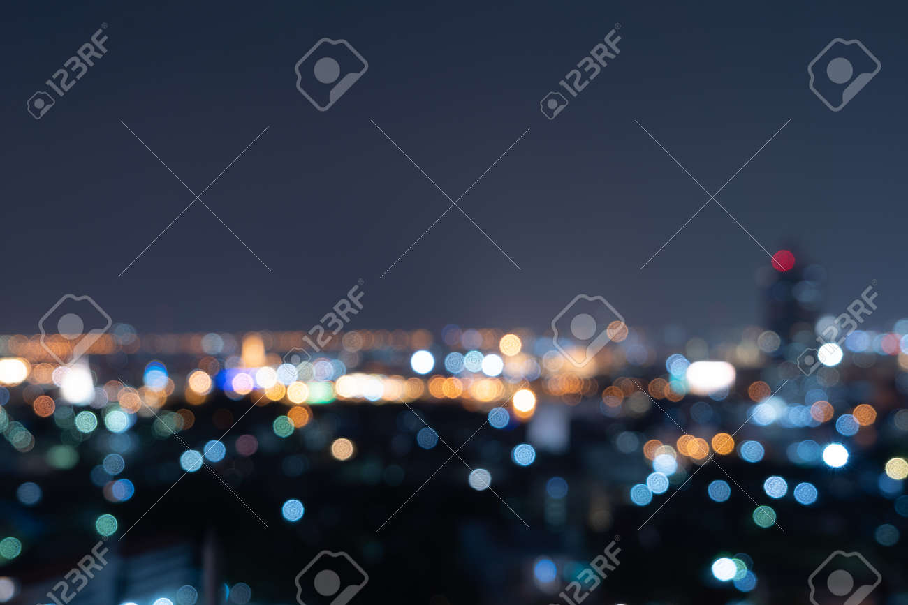 Bokeh abstract background of skyscraper buildings in Bangkok city, Thailand with lights, Blurry photo at night time. Cityscape. - 167554587