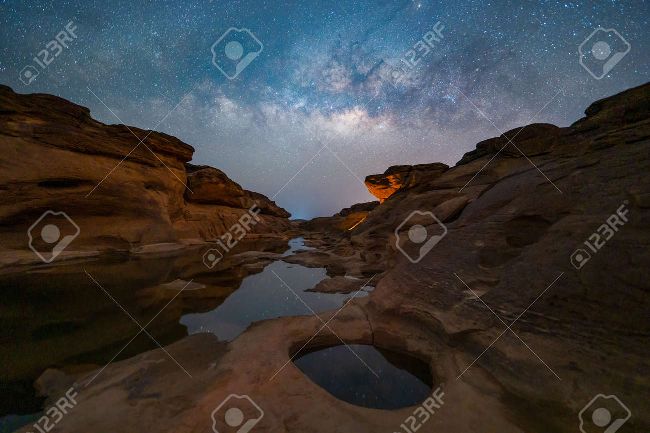 Sam Phan Bok with milky way and stars at night, Ubon Ratchathani, Thailand. Dry rock reef in the Mekong River with mountain hills. Nature landscape background. Grand Canyon of Thailand. - 168399202