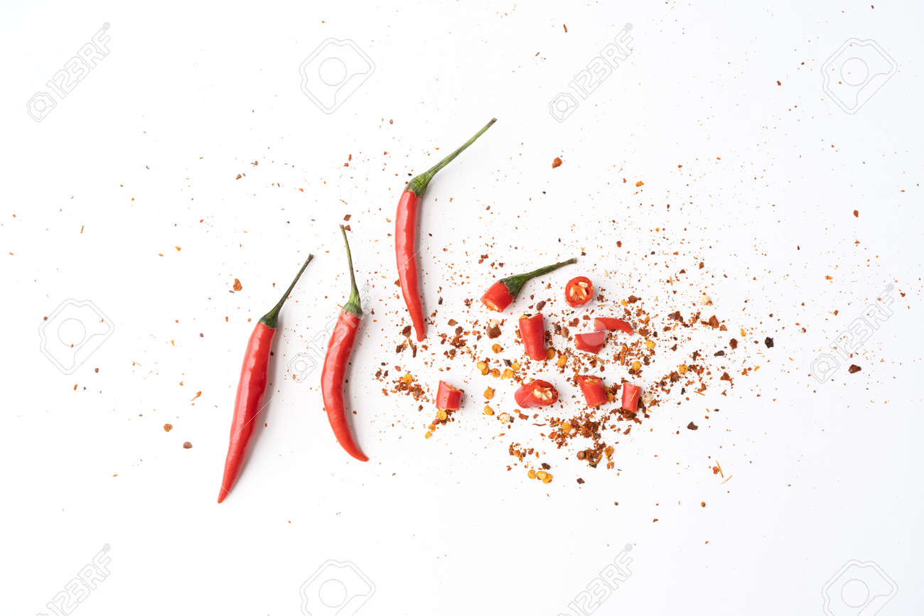 Chili peppers with sliced red chili peppers isolated on white background. Hot and spicy food. Vegetable. Seasoning ingredient. - 171980844
