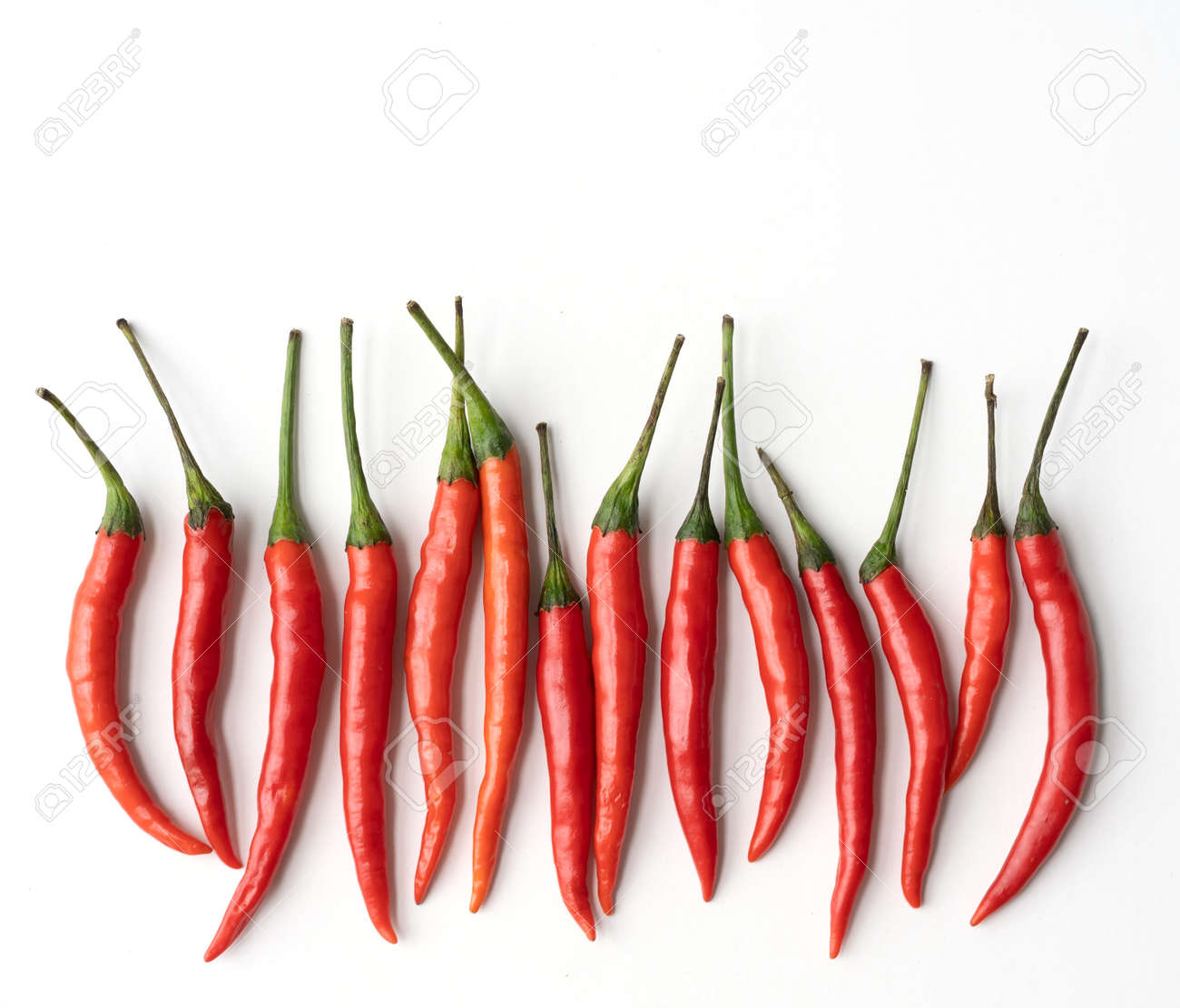 Chili peppers with sliced red chili peppers isolated on white background. Hot and spicy food. Vegetable. Seasoning ingredient. - 172003129