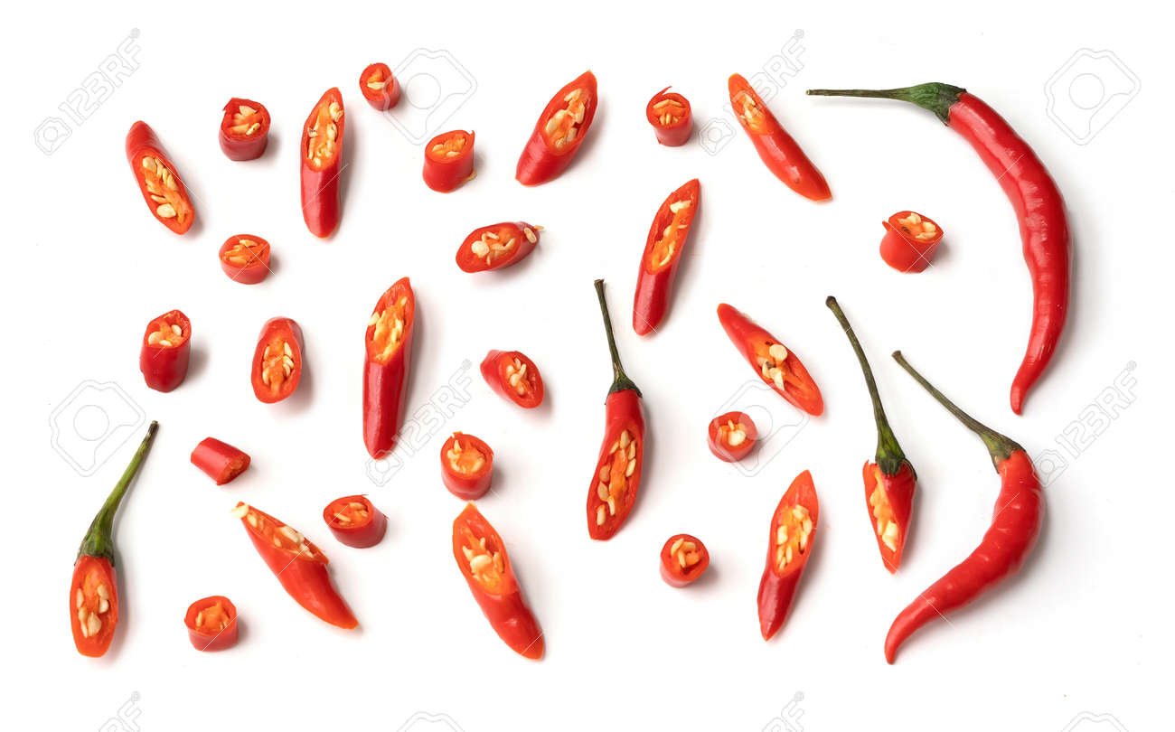 Chili peppers with sliced red chili peppers isolated on white background. Hot and spicy food. Vegetable. Seasoning ingredient. - 172003131