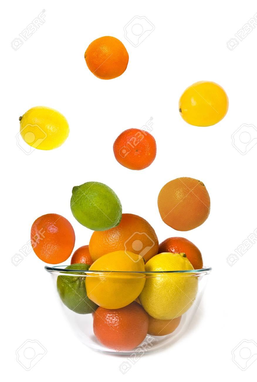 Bowl of citrus fruits on white background Stock Photo - 4151610