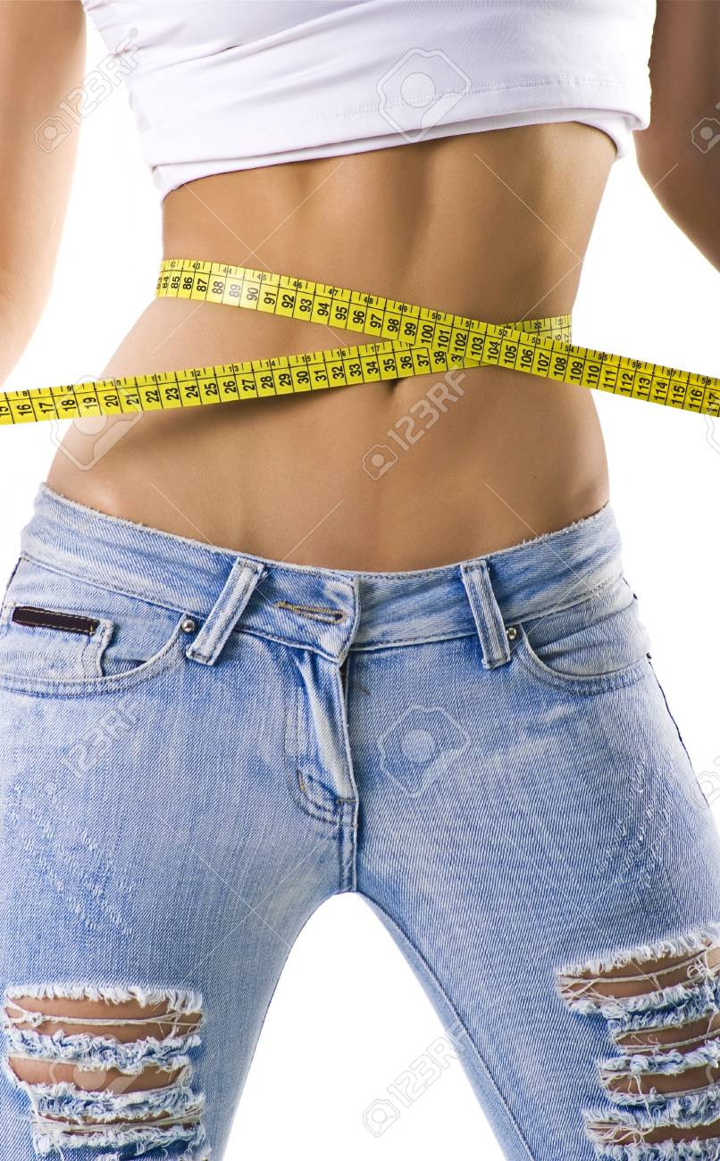 Woman measuring her small waist isolated on white Stock Photo - 4523397