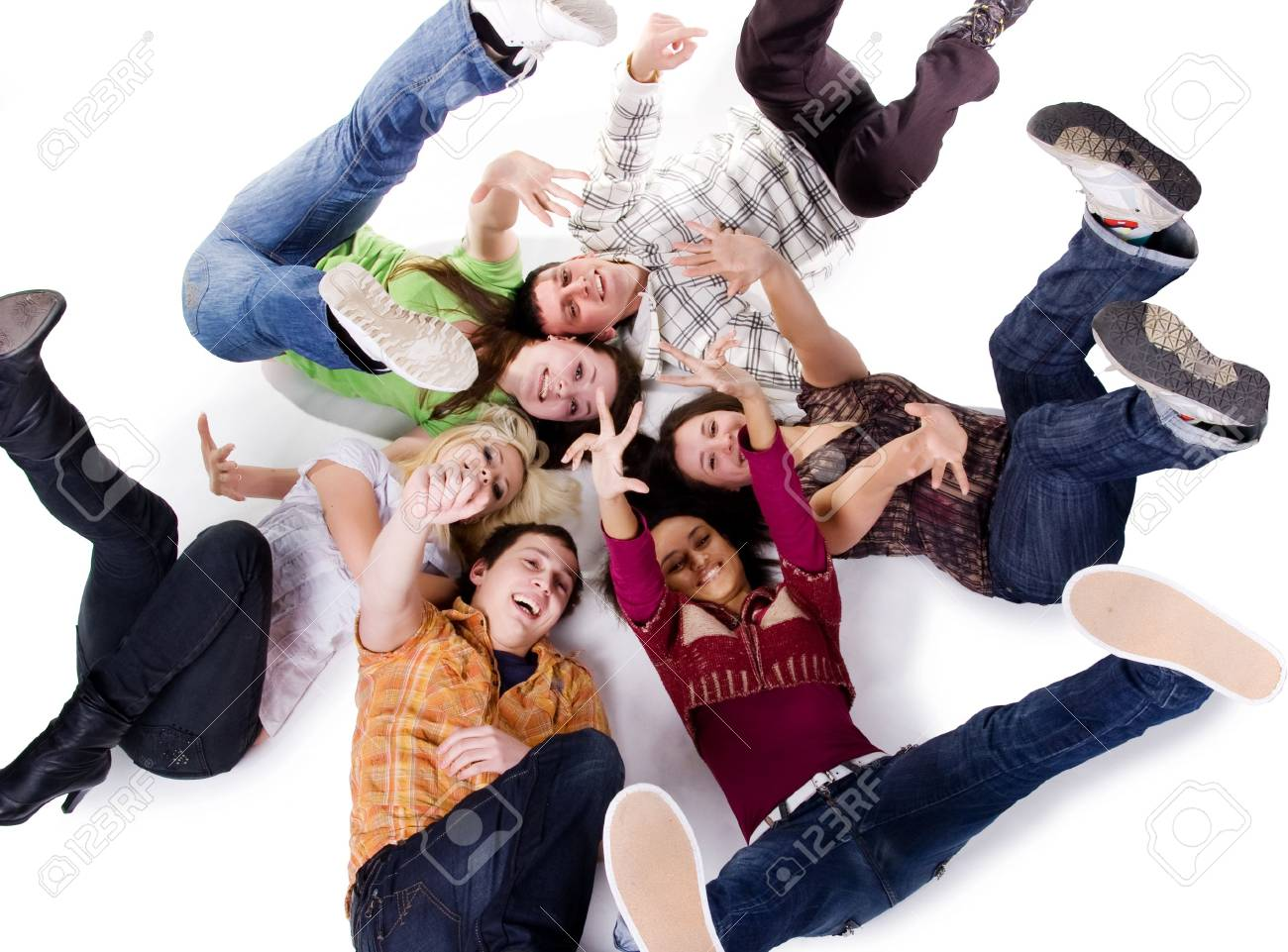 Group of carefree teenagers lie on the floor Stock Photo - 6310696