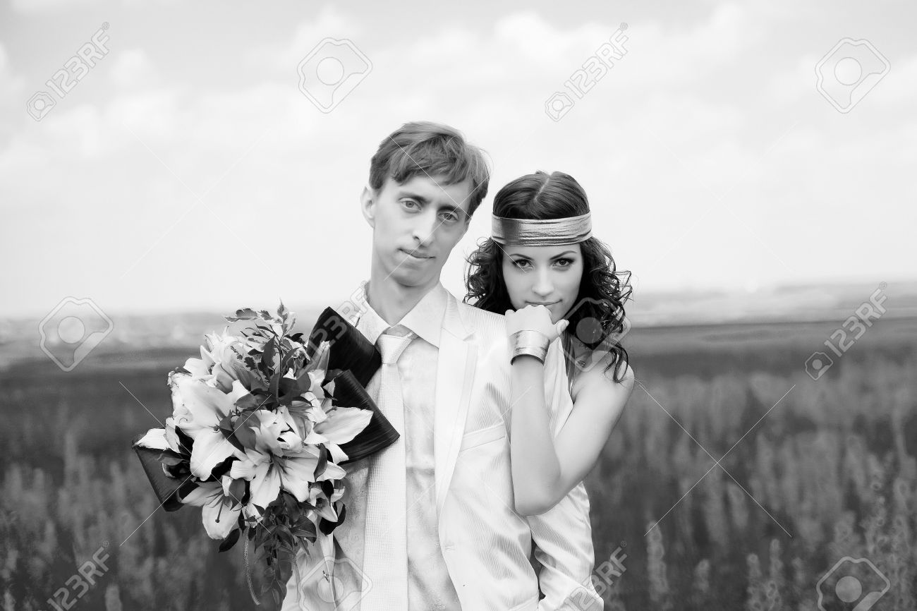 Just married couple on the field black and white photo stock photo