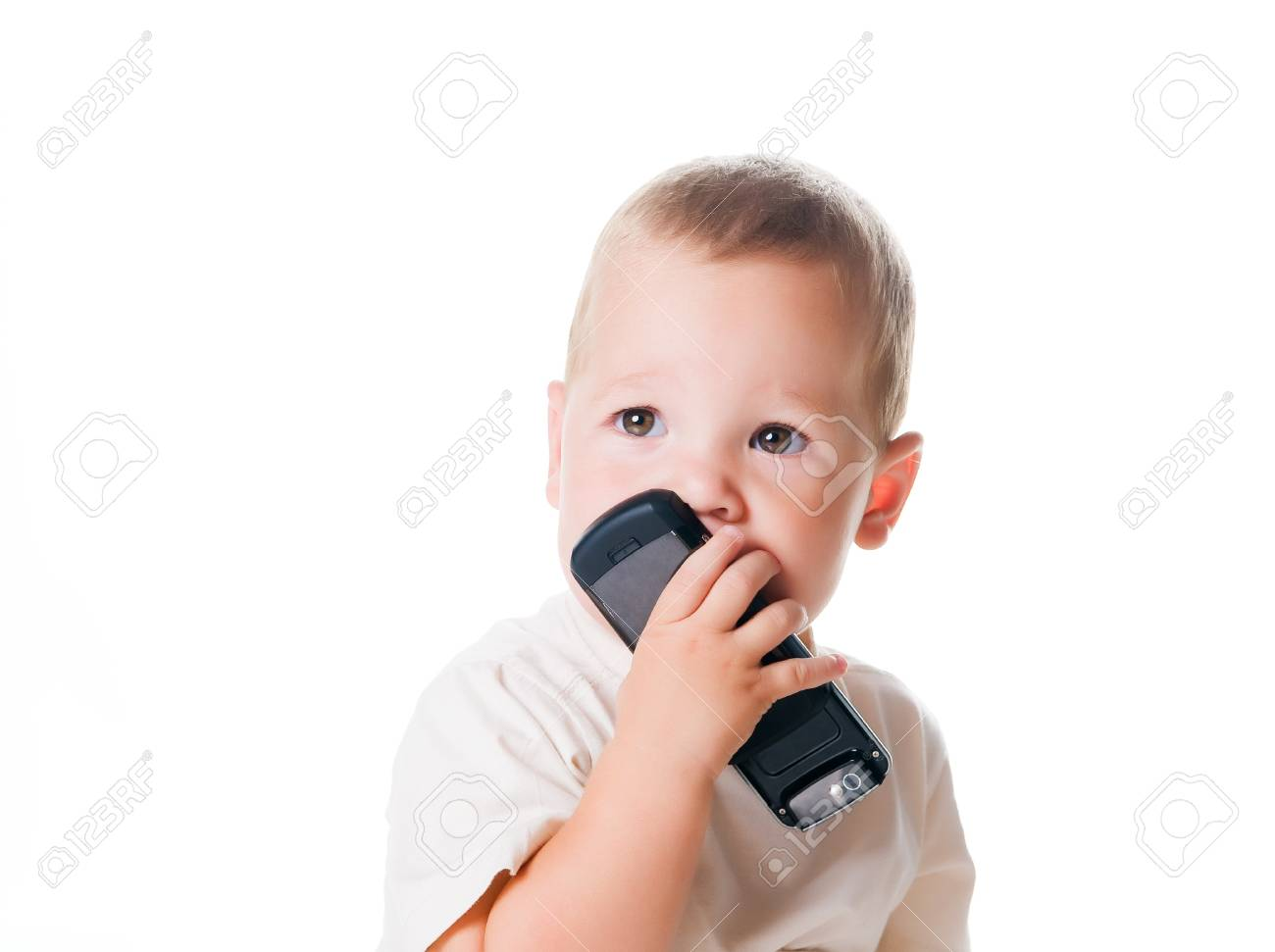 Little boy with the phone. Isolated on white - 7812636