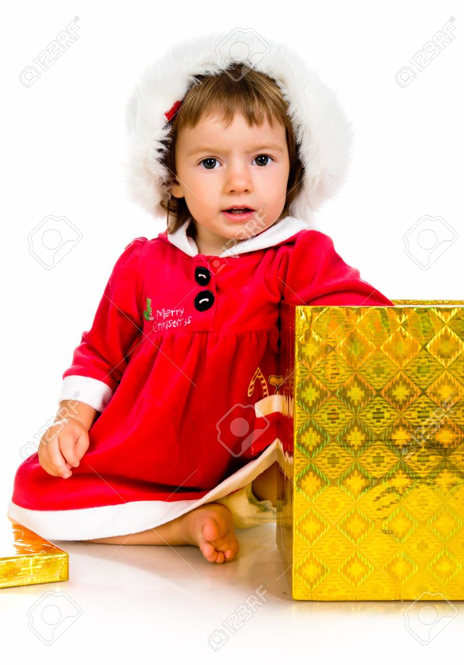 little girl in santa hat with presents Stock Photo - 10226059