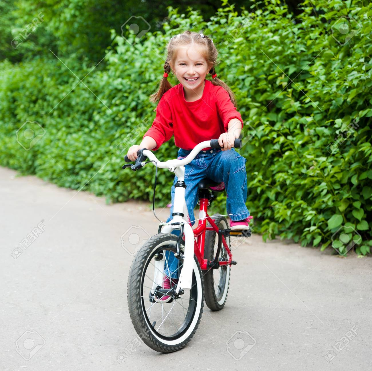 little girl with her bicycle Stock Photo - 13664434