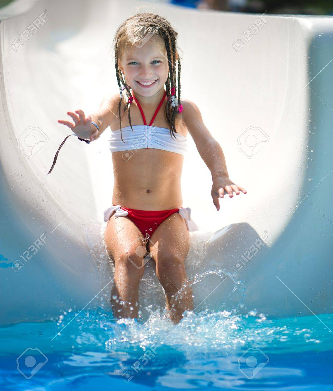 Little girl on water slide at aquapark  Summer holiday Stock Photo - 18616604