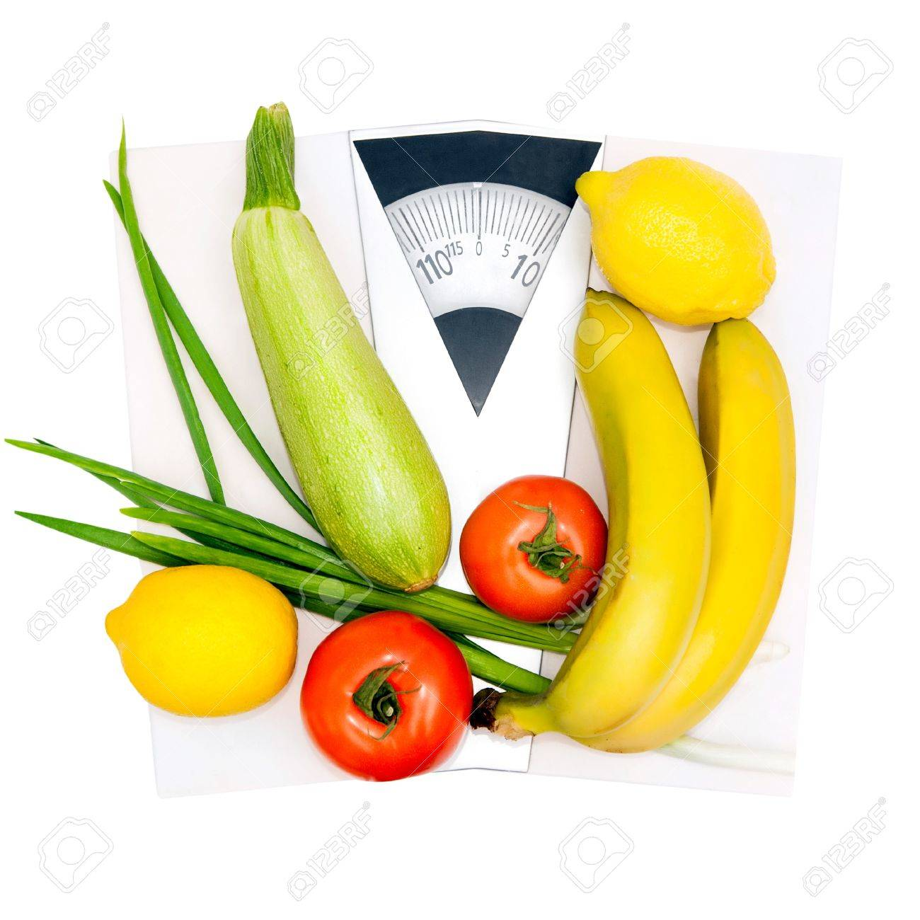 Diet and nutrition  Vegetables and fruits on the scales Stock Photo - 18949750