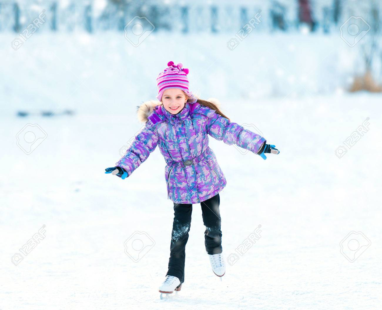 Happy little girl skating in winter outdoors - 32218926
