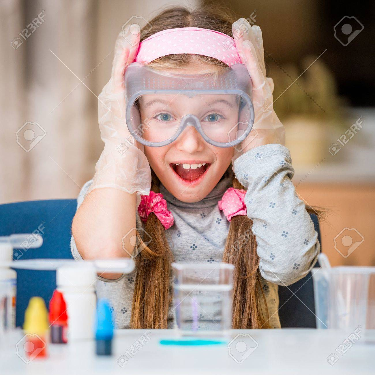 happy little girl with flasks for chemistry - 34159095