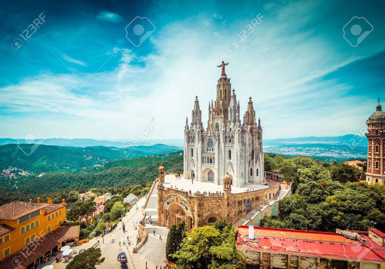 Tibidabo church on mountain in Barcelona with christ statue overviewing the city - 34161300