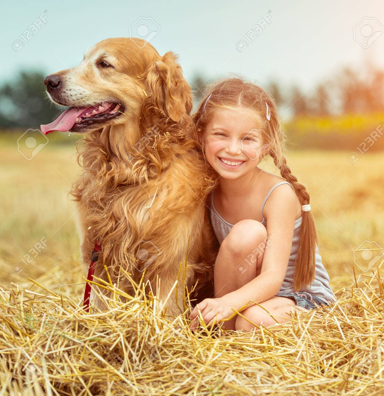 happy little girl with her dog - 36275383