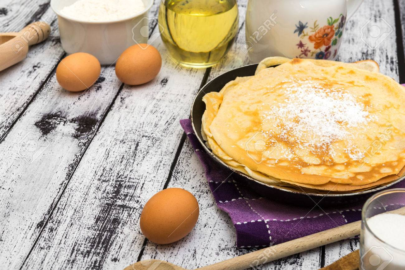 stack of pancakes and ingredients on a wooden background - 37189758