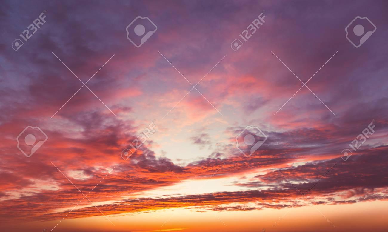 Fiery sunset sky. Beautiful clouds - 38489263
