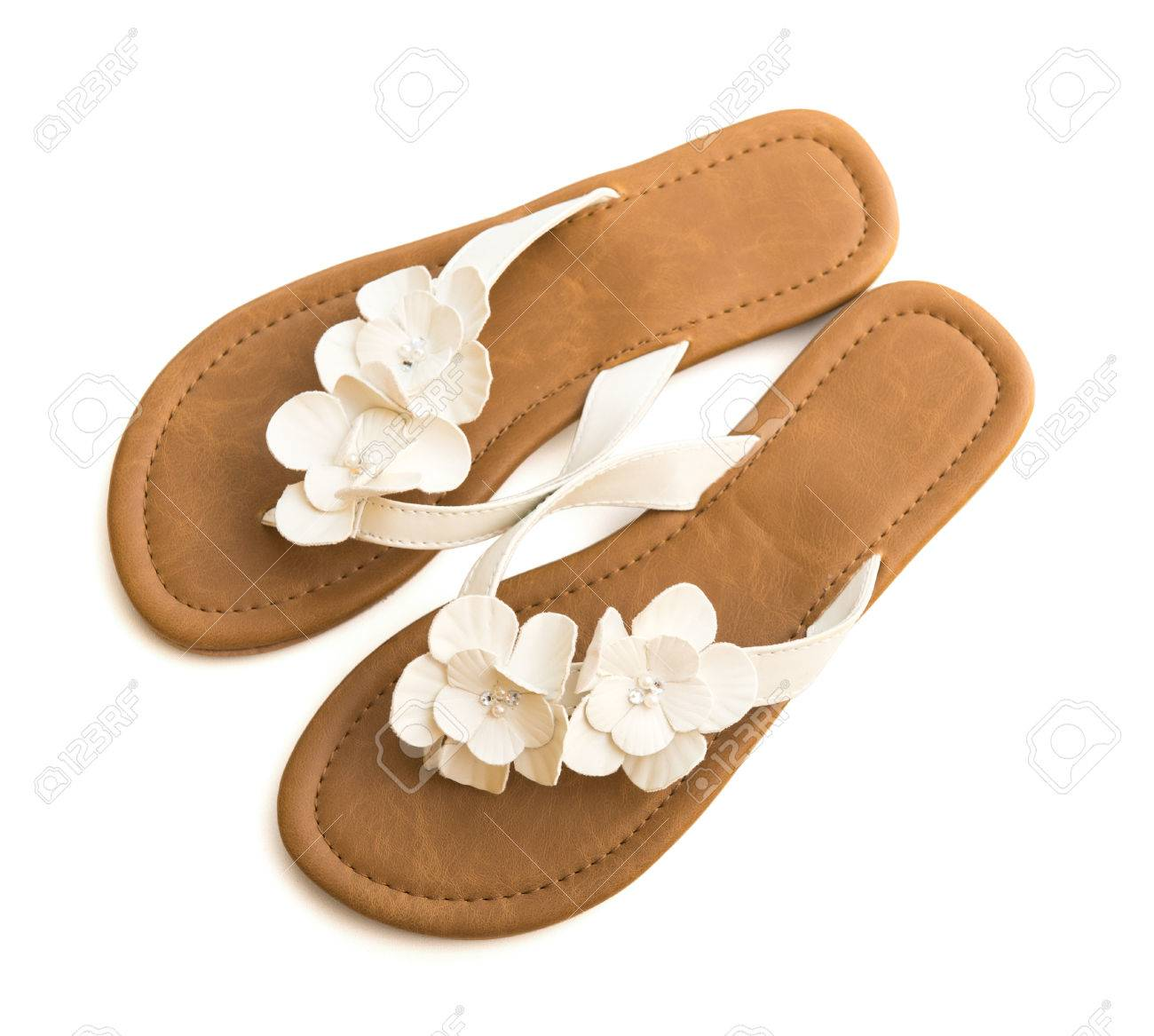 e7af9dd4f320 flip-flops with flowers on white isolated Stock Photo - 38585448