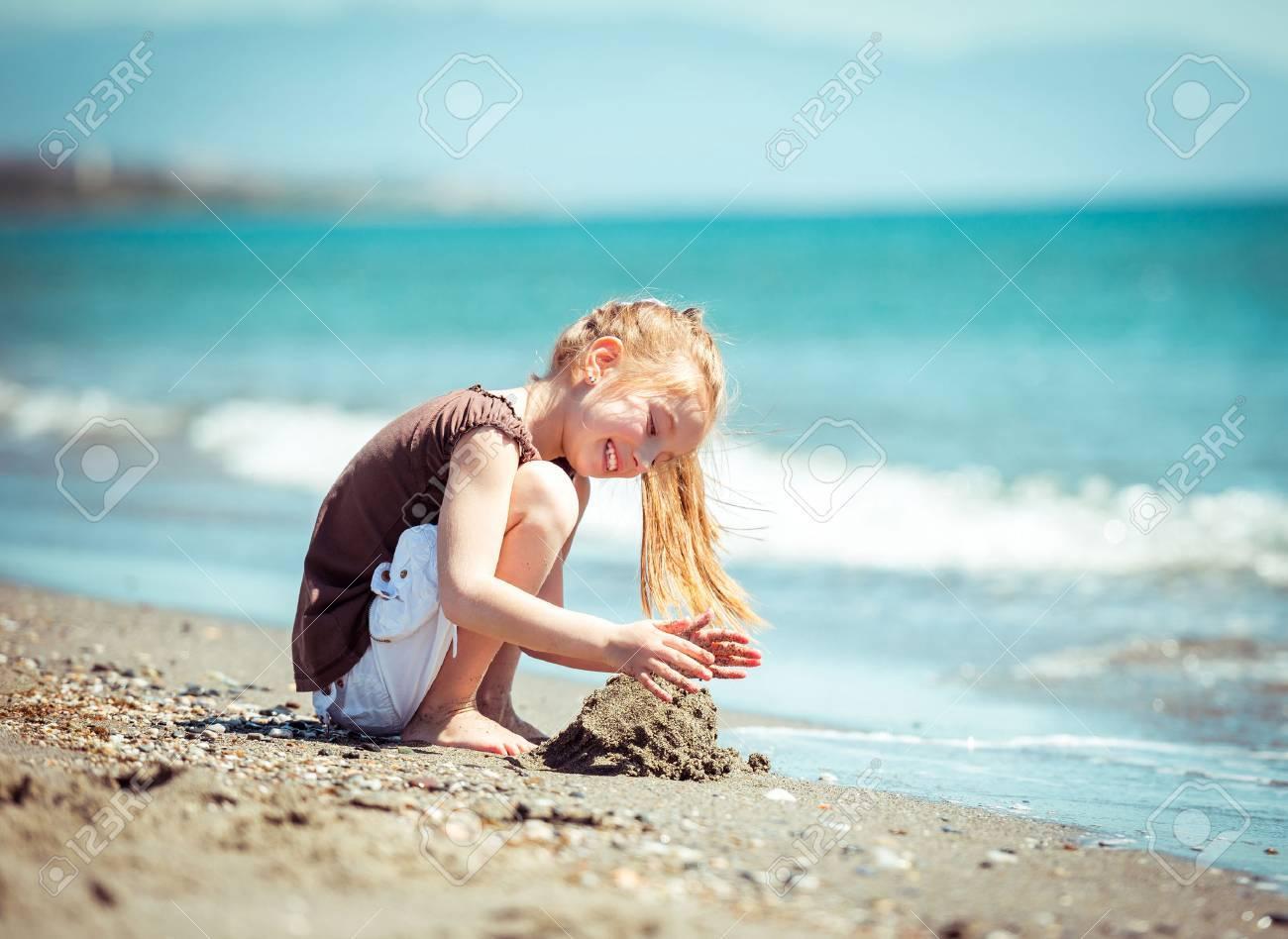 cute little girl run on tropical beach vacation - 39461607