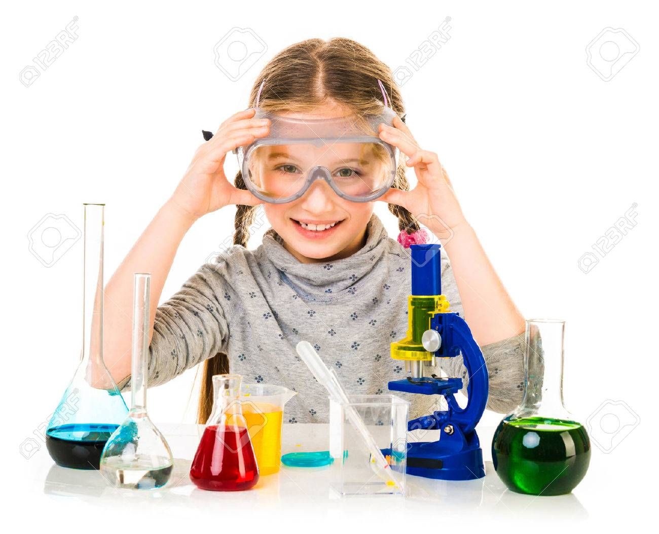 happy little girl with flasks for chemistry isolated on a white background - 39465264