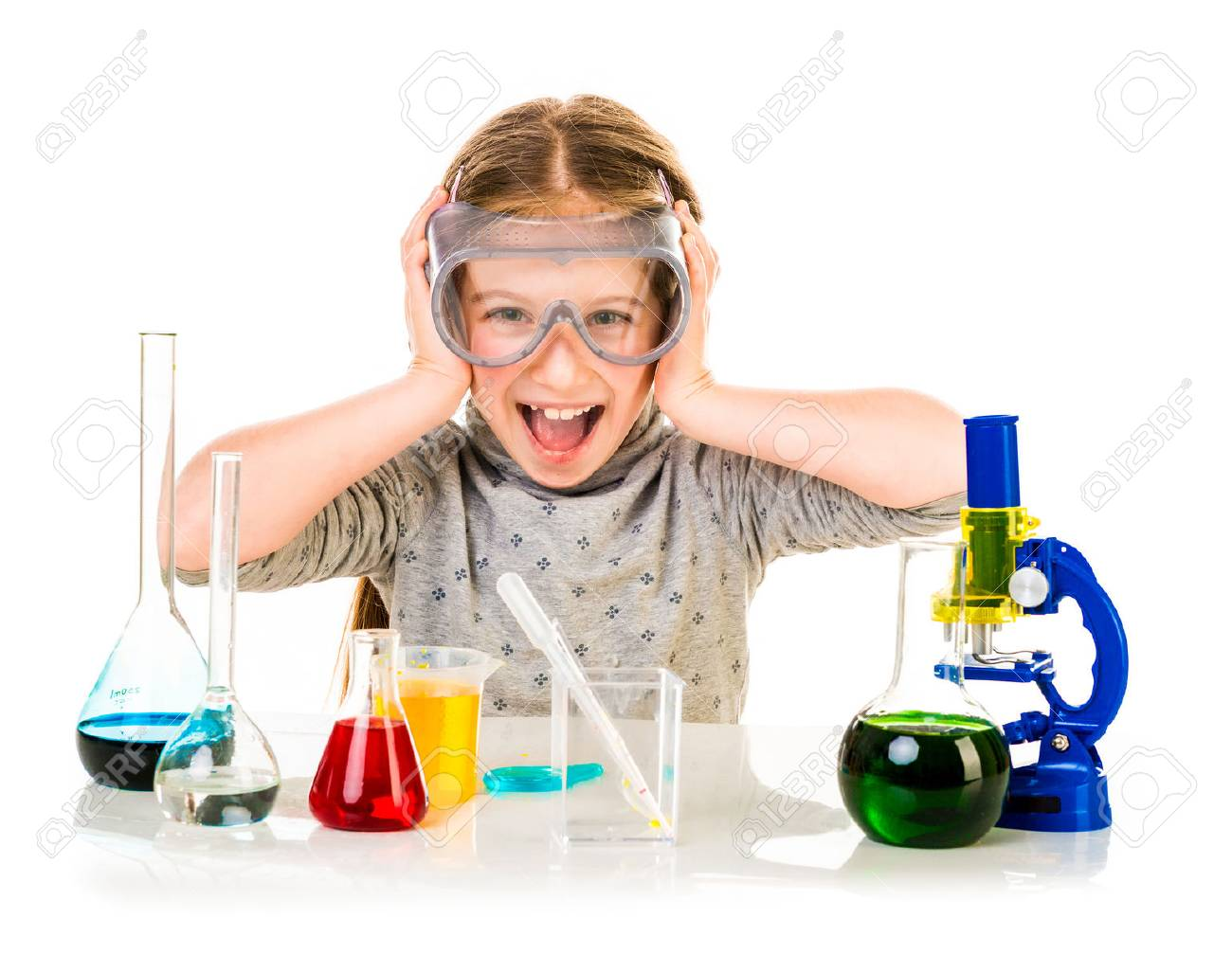 happy little girl with flasks for chemistry isolated on a white background - 39465268