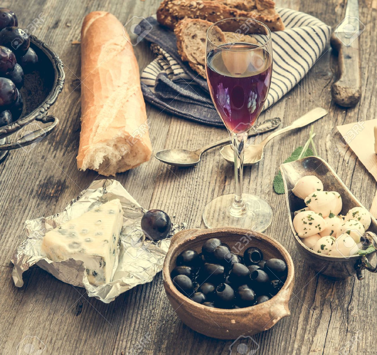French cuisine. Different types of cheese, wine and other ingredients on a wooden table - 40314290