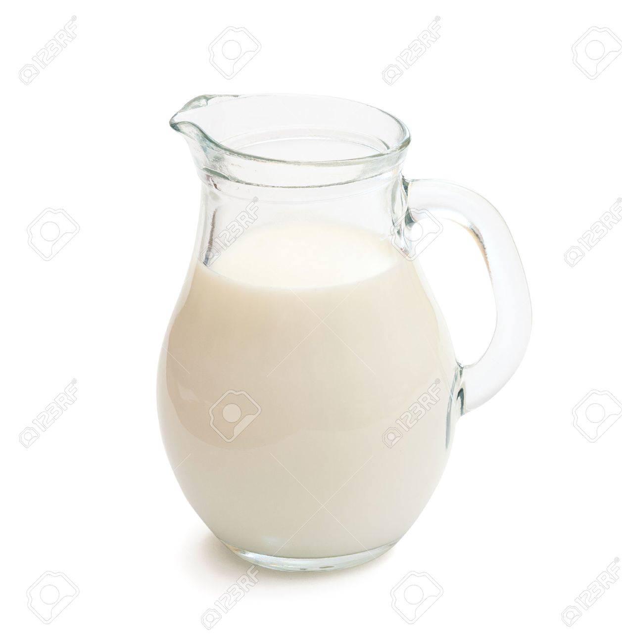 Glass jug of fresh milk isolated on white - 41509851