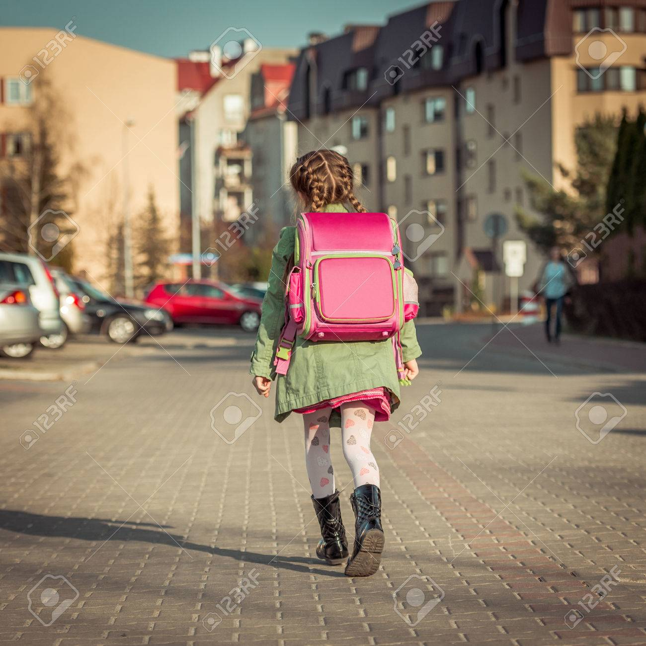 little girl with a backpack going to school - 43021404
