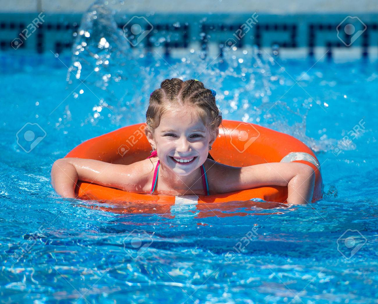 happy cute girl swims with a lifeline in the pool in summer Stock Photo -  43021494 8ca129bfb