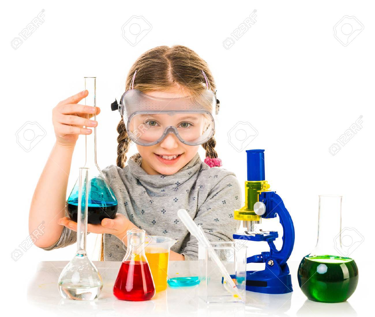 happy little girl with flasks for chemistry isolated on a white background - 43021512