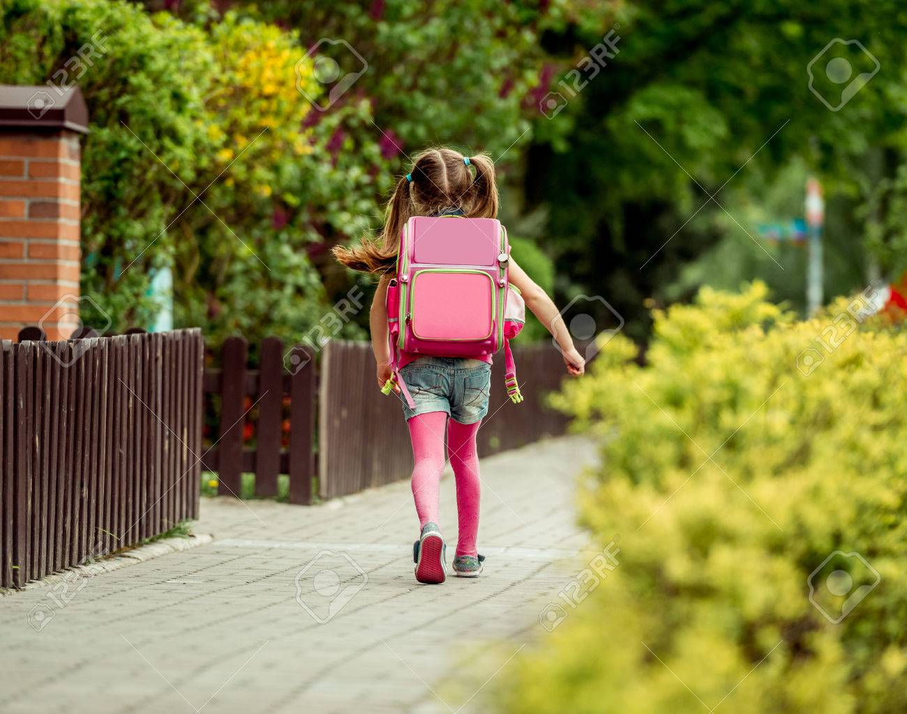 little girl with a backpack going to school. back view - 43021549