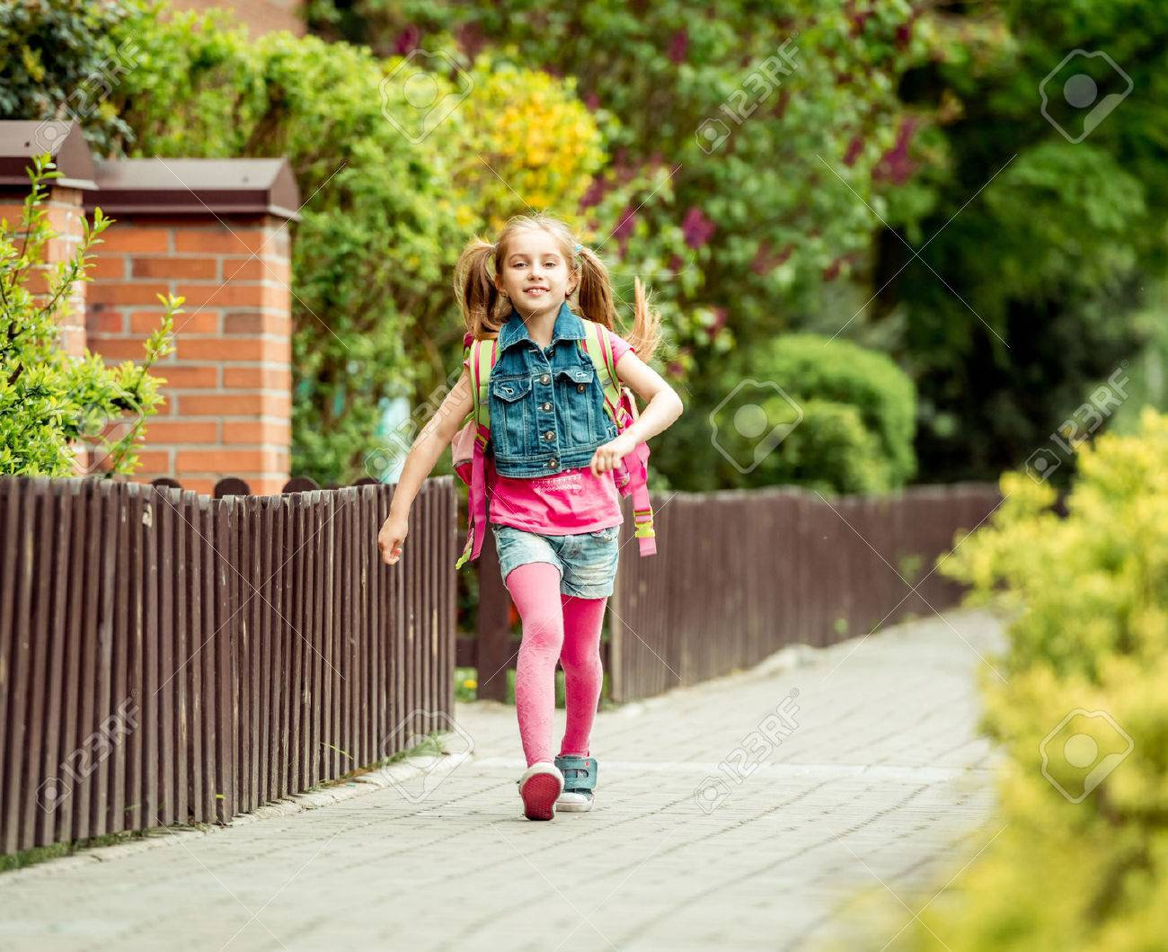 little girl with a backpack going to school. - 43021550