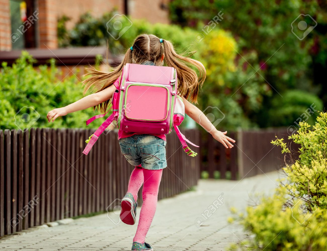 little girl with a backpack run to school. back view - 43021551