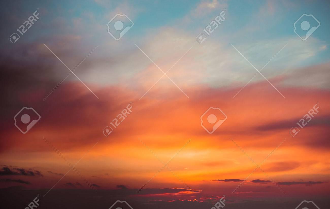 Fiery sunset sky. Beautiful clouds - 43286917