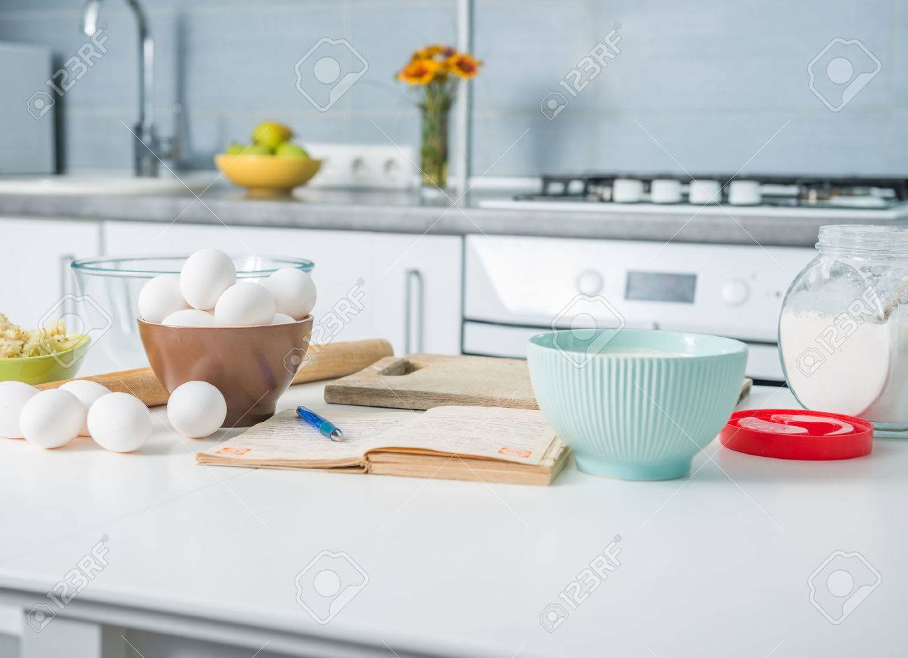 ingredients for baking and recioe book on a kitchen table - 43785616