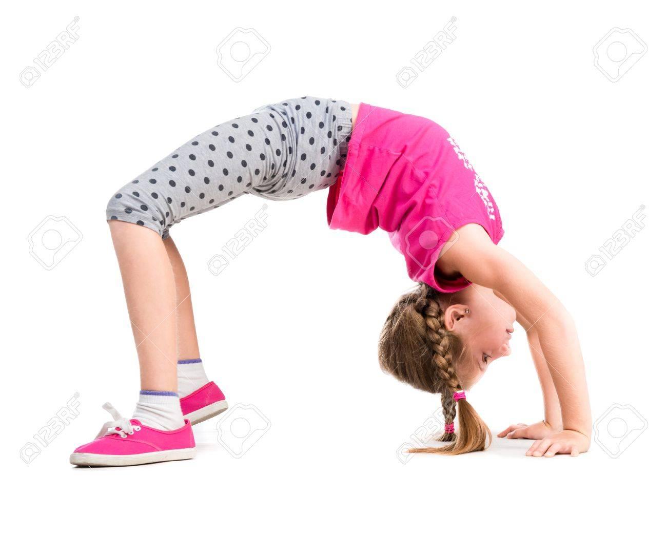 little girl doing the bridge exercise isolated on white background - 44481561