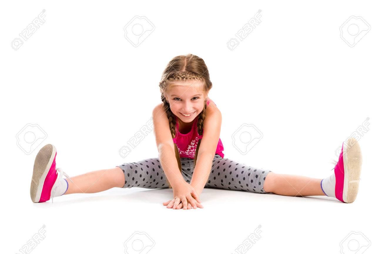 little girl doing yoga isolated on white background - 44481559