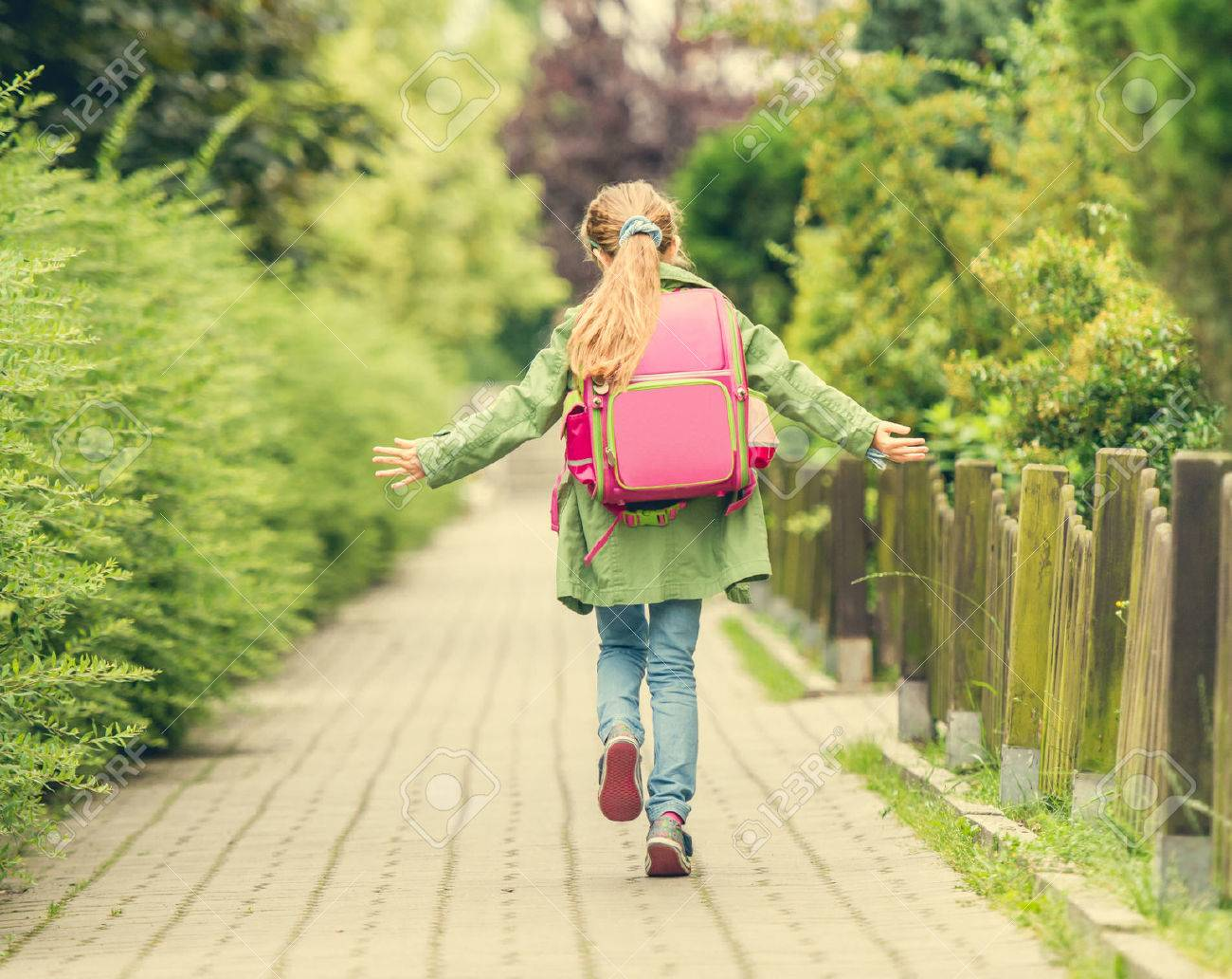 little girl with a backpack going to school. back view - 44481580