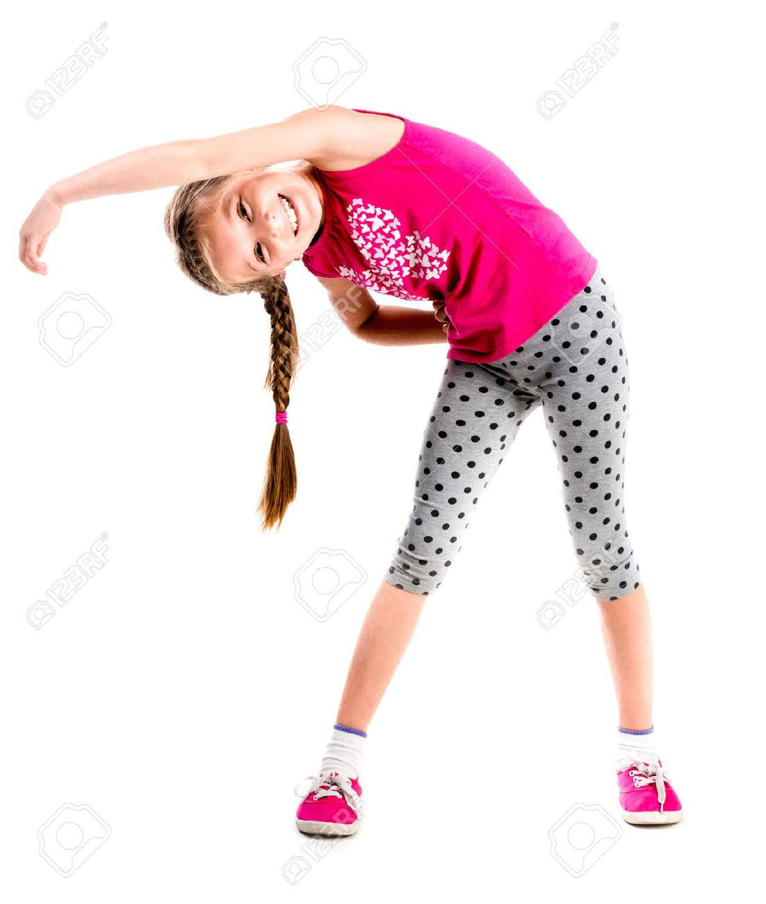 little girl standing with hands on sides doing fitness - 44481587