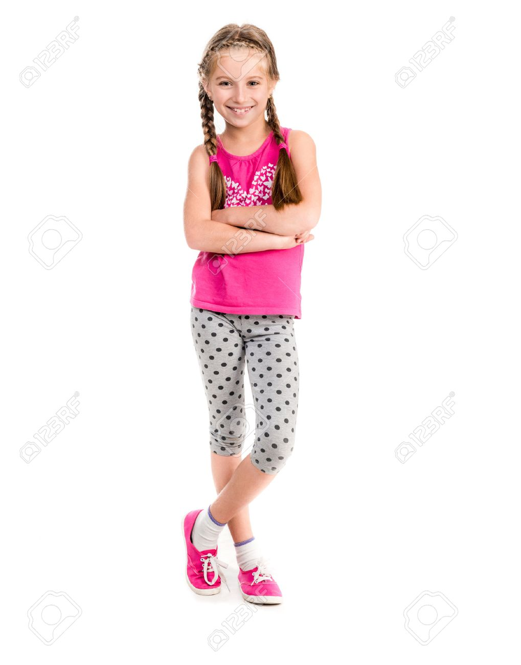 little girl standing with hands on sides doing fitness - 44481590